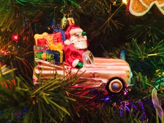 This ornament is my absolute favorite. I have started a little car collection and this one is actually from a personal collection and my mom had to battle it out to win it at an auction for me. It won't be coming with me to the apartment- I'm waiting for my first house to move this gem.